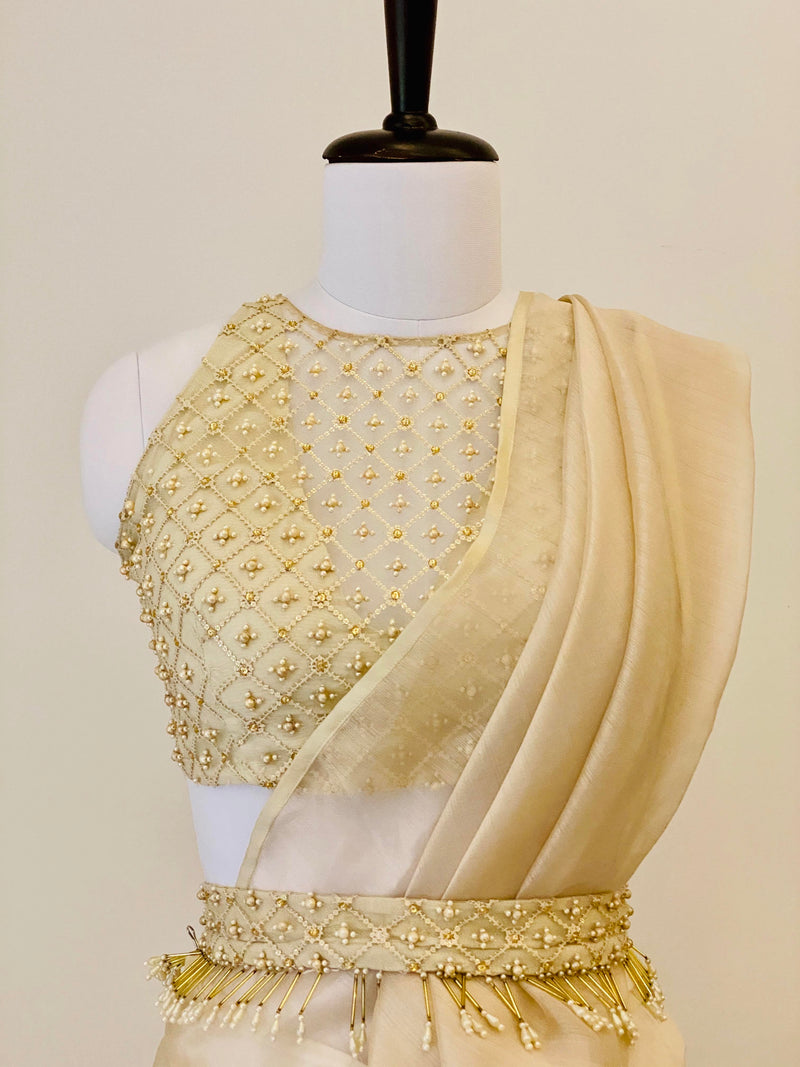Champagne drape saree with pants and pearl work belt