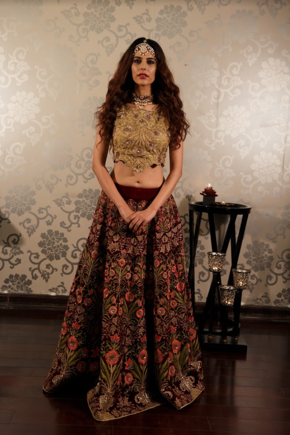 Heavy Embroidered velvet lehenga with a gold blouse