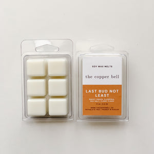 scented soy wax melts in sweet grass, plumeria, sea salt, and ylang ylang scent. the scent name is last bud not least