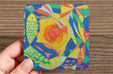 Image of a coaster featuring art by Mila Lansdowne from the Designer Collection Ocean of Plenty - Abundance.