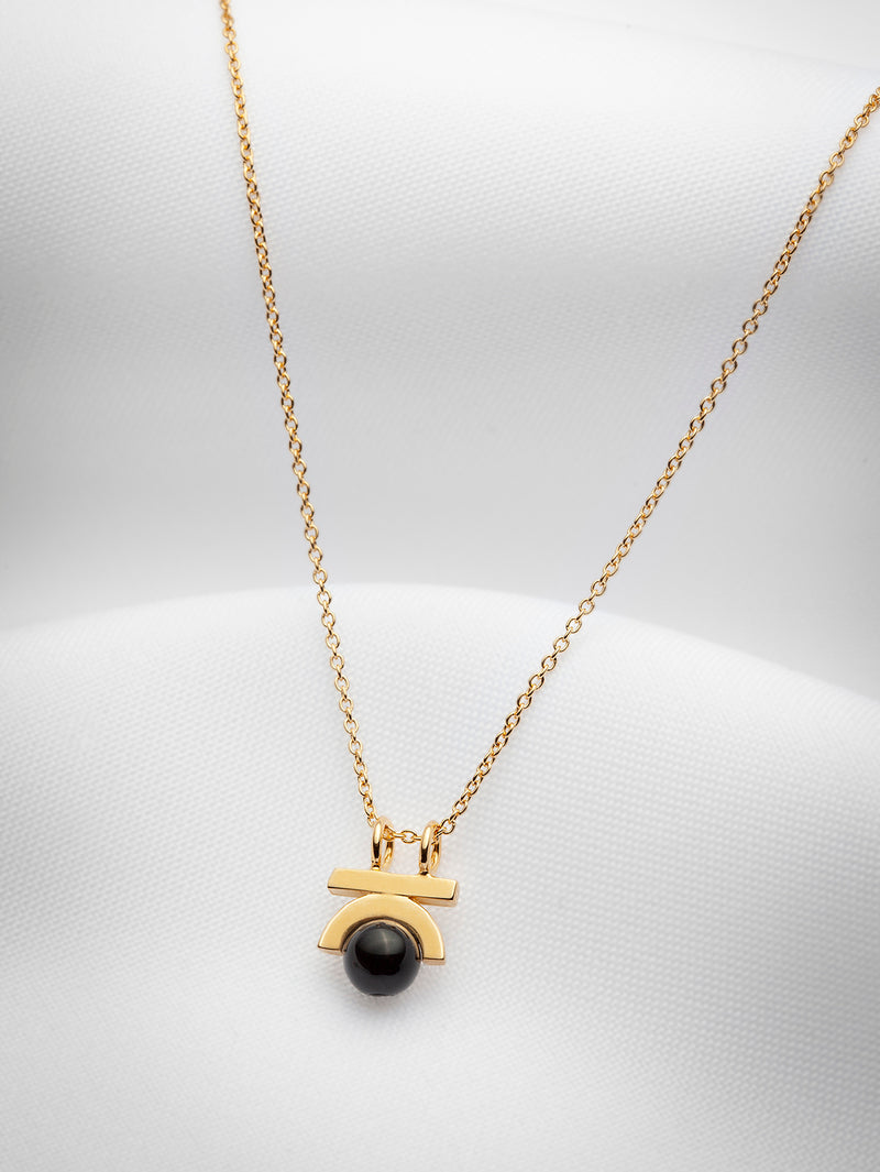 Small gold vermeil and black onyx pendant necklace by Ve jewelry