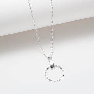 Long silver necklace with a circle and vertical bar pendant
