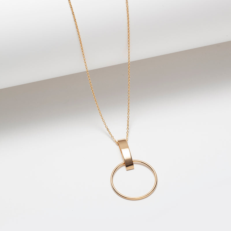 Long gold plated circle and vertical bar pendant necklace