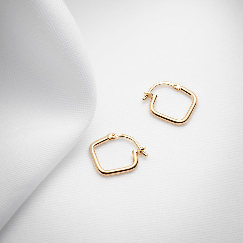 Gold vermeil thin hoop earrings with hinged backing