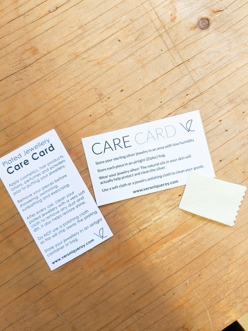 Complimentary sterling silver and gold plated care card from Ve jewelry