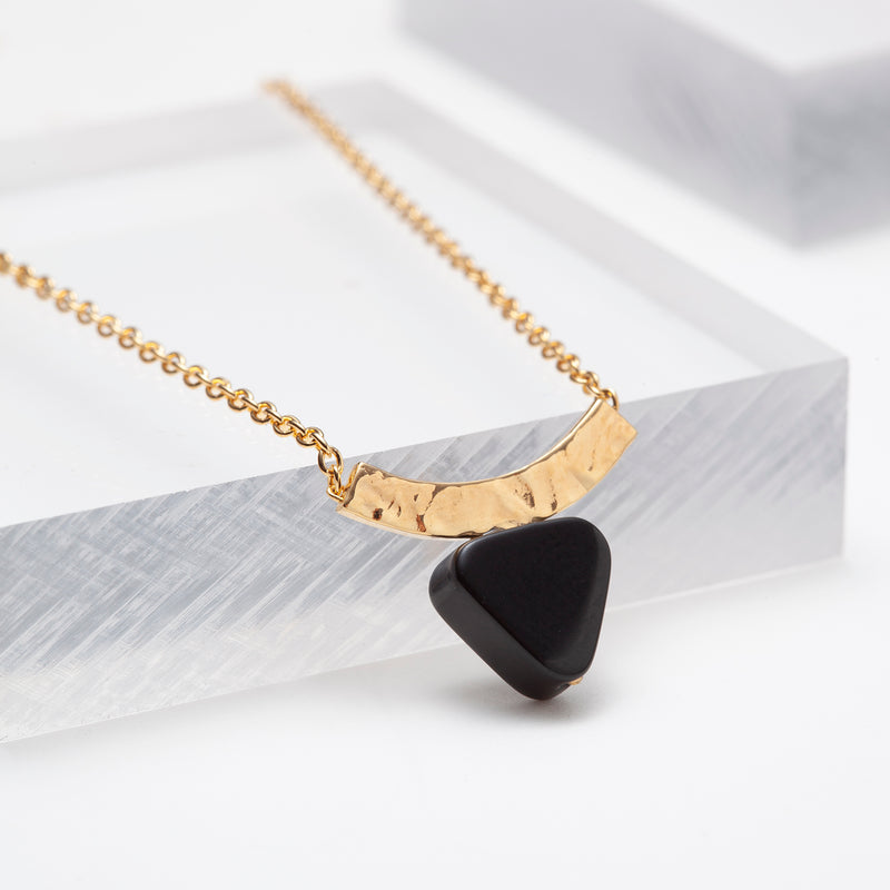 Gold plated hammered curved bar chain necklace with triangle black onyx