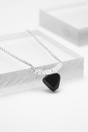 Sterling silver curved bar chain necklace with a triangle black onyx stone