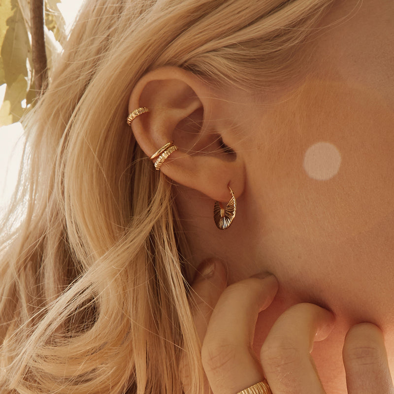 Tiny gold ear cuffs