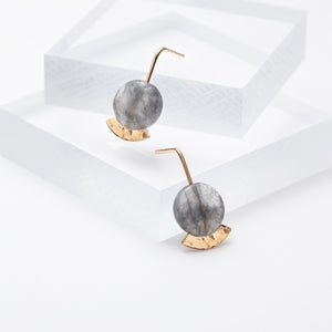 Gold plated long dangle stud earrings with grey stones