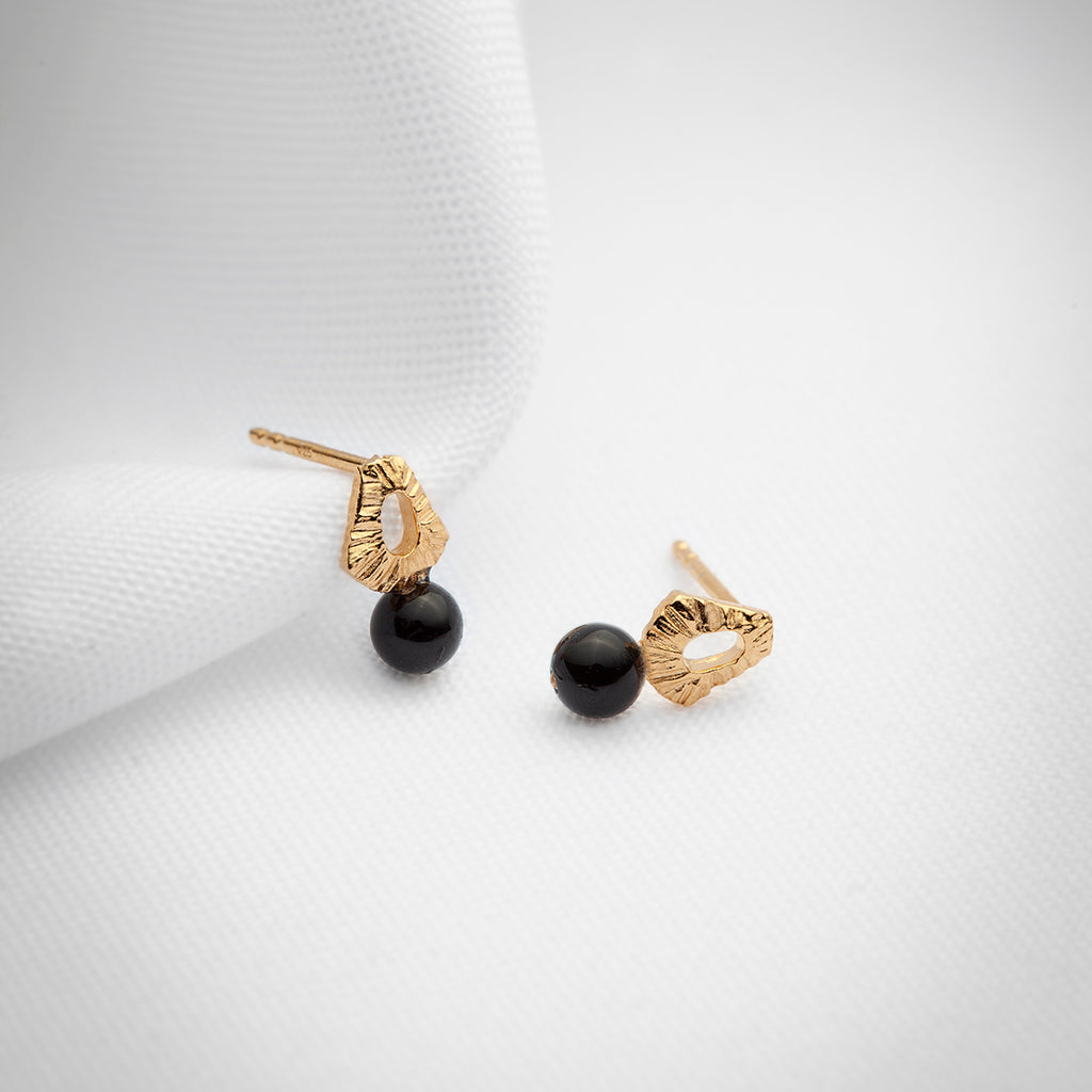 Small gold studs with black onyx