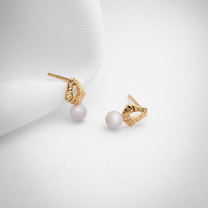 Delicate gold stud earrings with blue lace agate