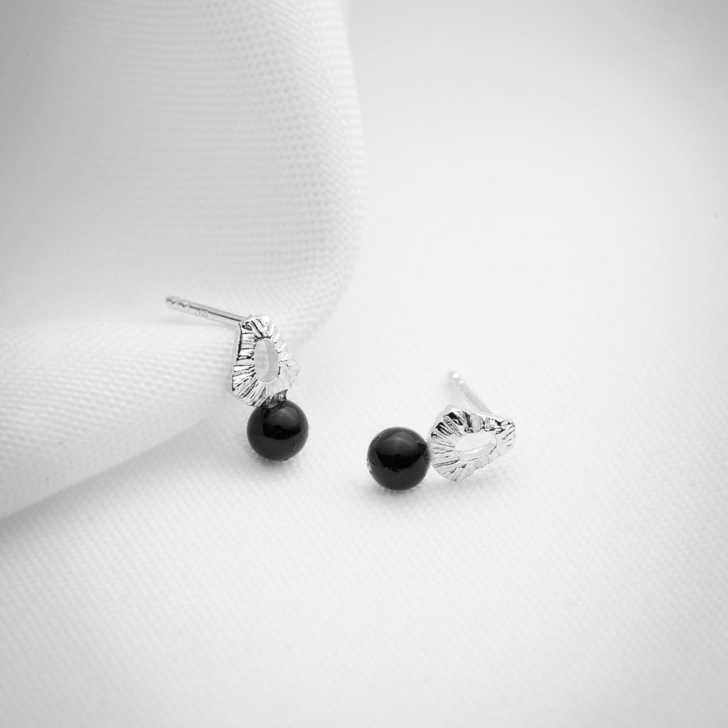 Dainty silver stud earrings with black onyx