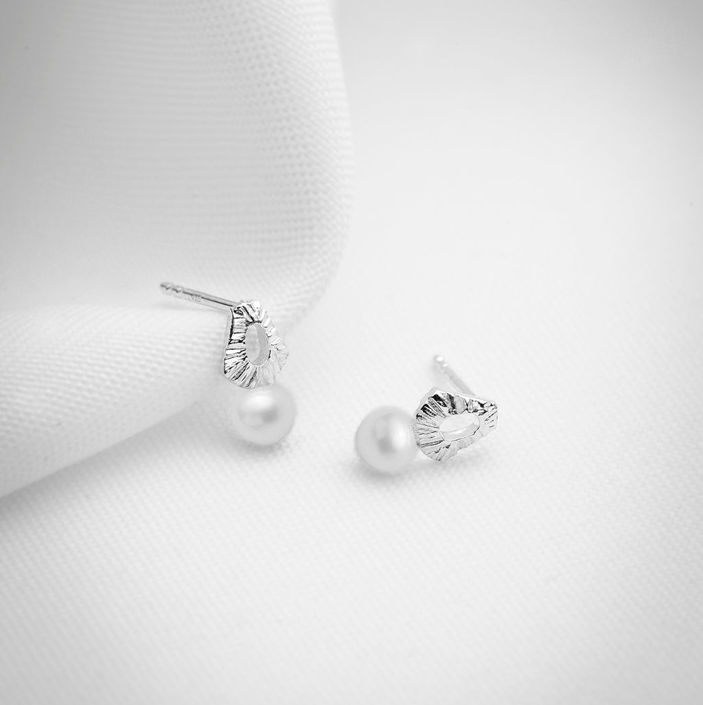 Small pearl stud earrings in sterling silver