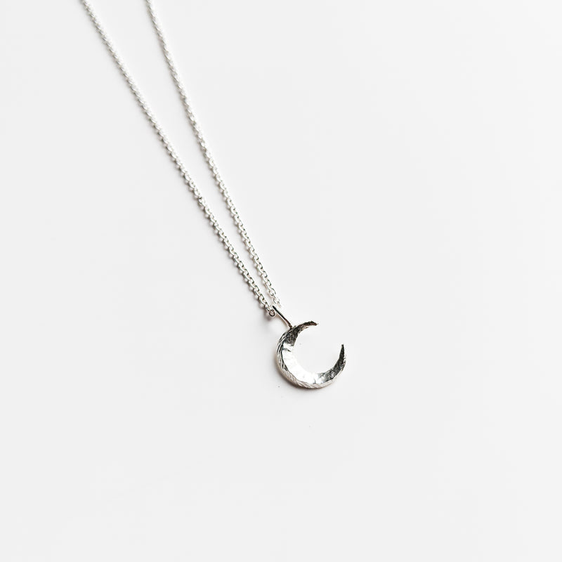 Textured sterling silver moon charm necklace