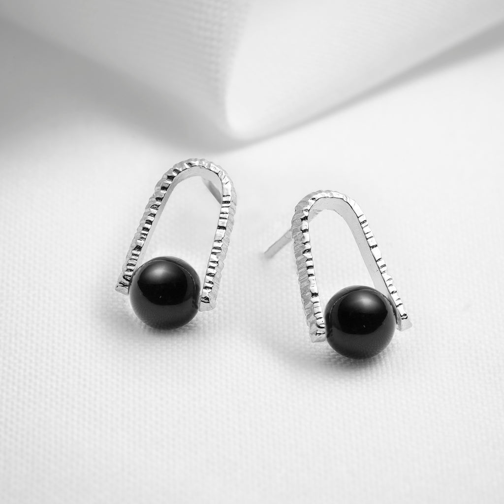 Black onyx floating gemstone stud earrings in sterling silver