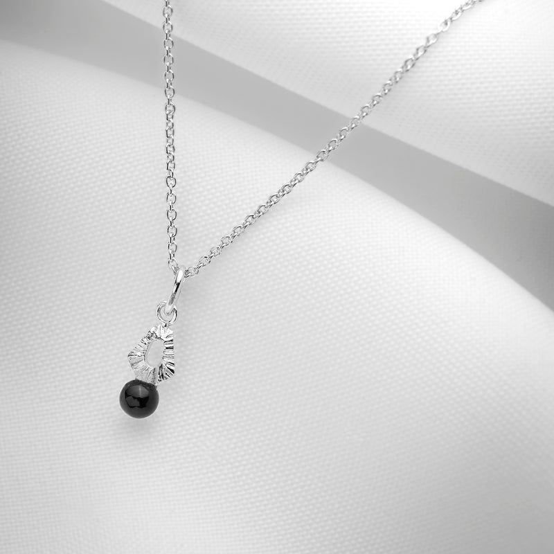 Small black onyx charm necklace
