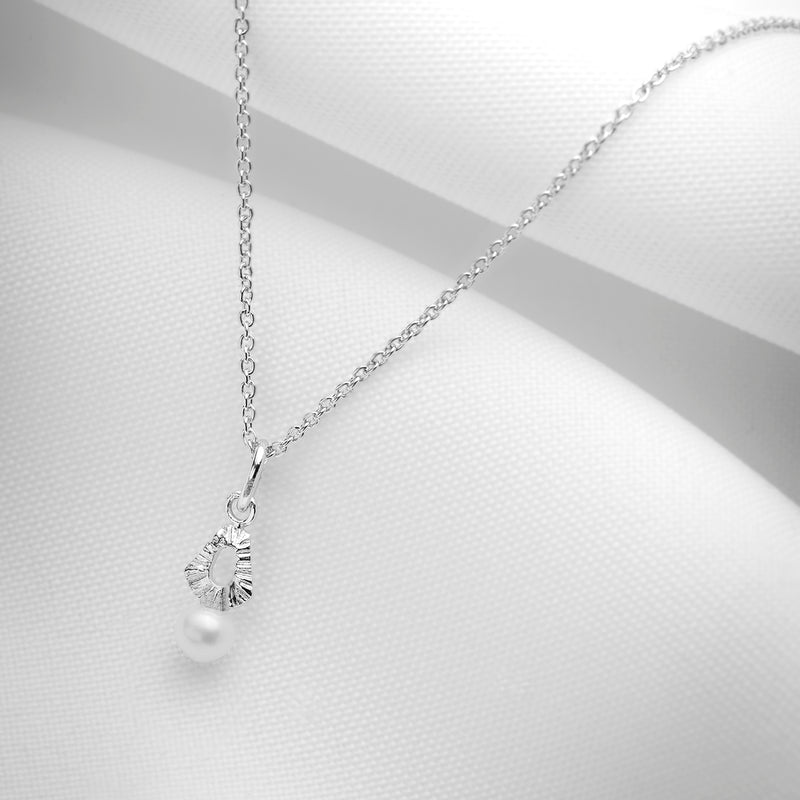Small pearl pendant on chain in silver