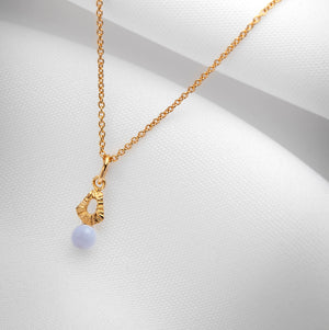 Handmade gold charm necklace with blue lace agate agate