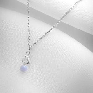 Silver charm necklace with tiny blue lace agate stone