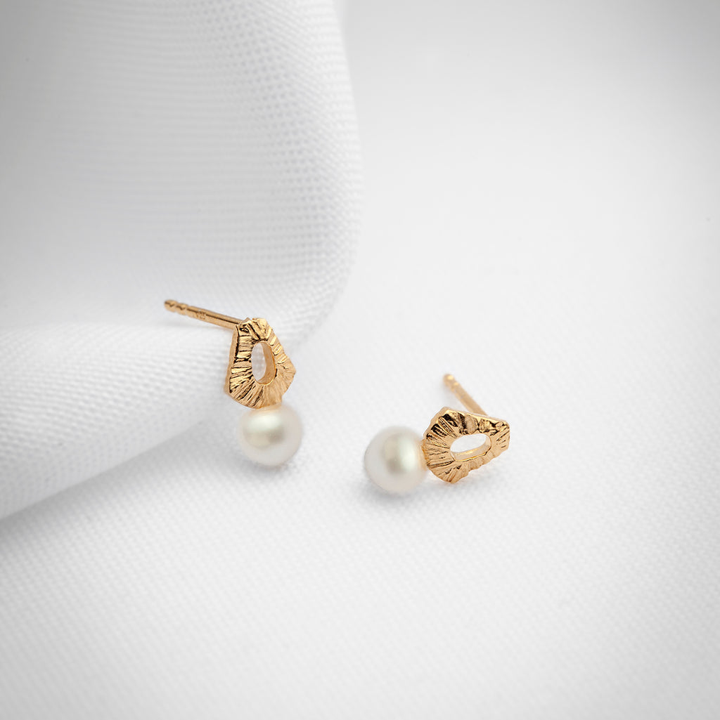 Dainty gold plated textured earrings with natural pearls
