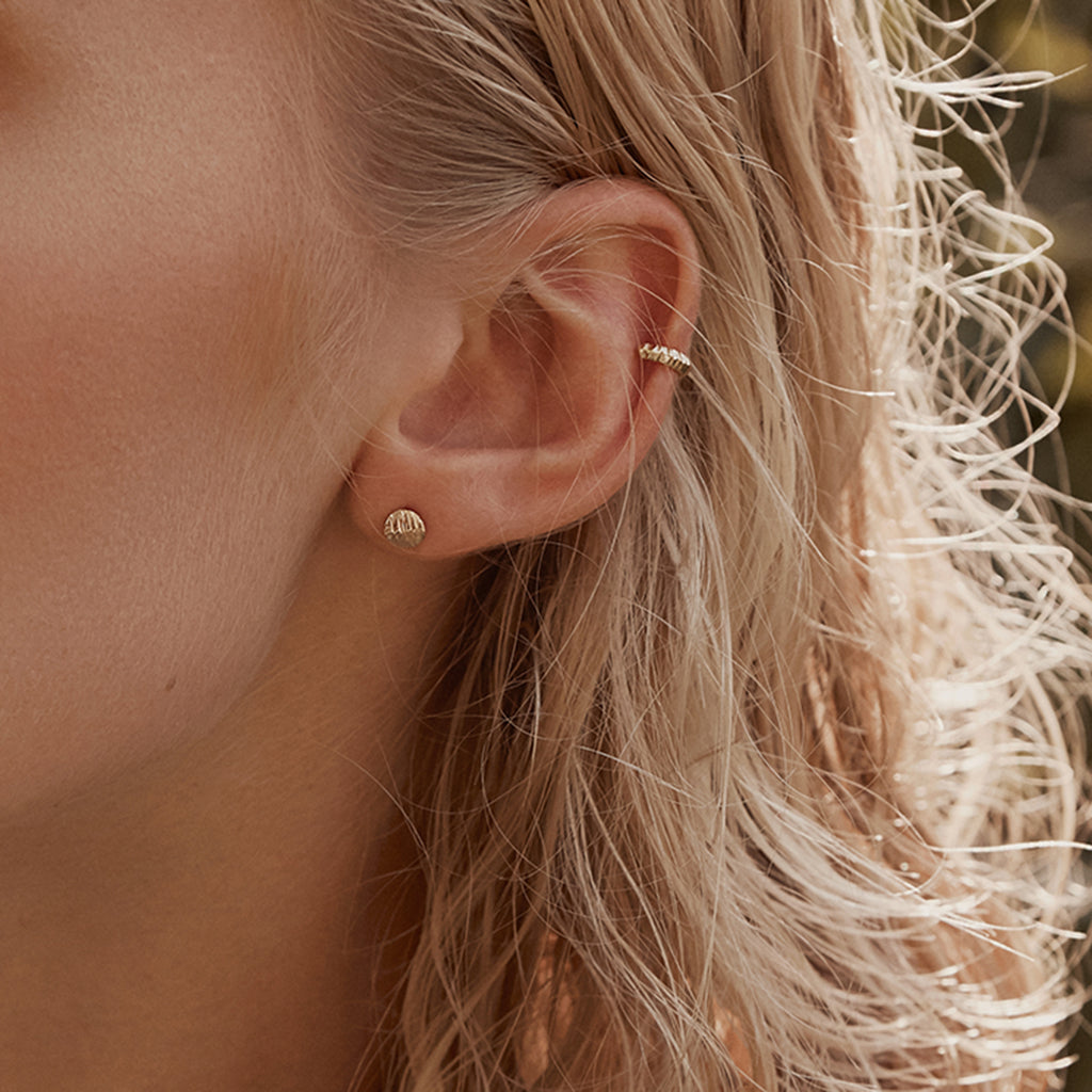 Flat textured disc gold stud earrings and ear cuff