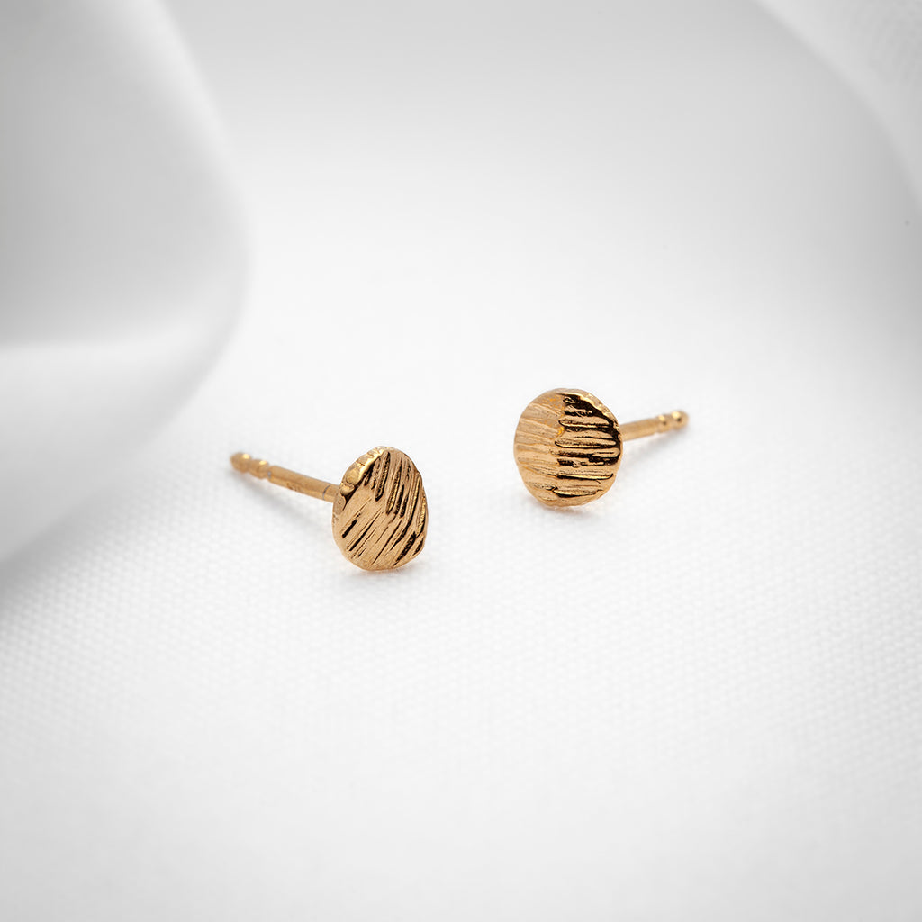 Flat textured disk gold stud earrings