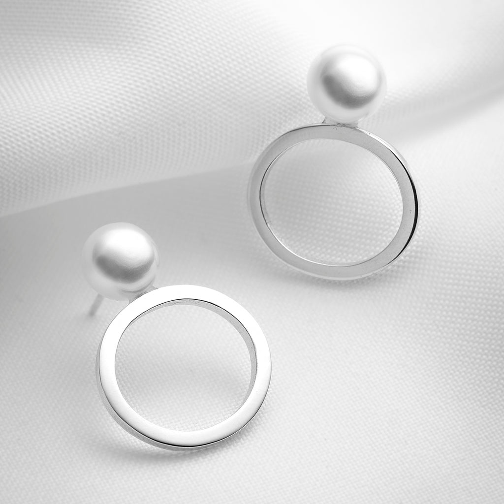 Nix, big pearl button stud earrings with oval shapes
