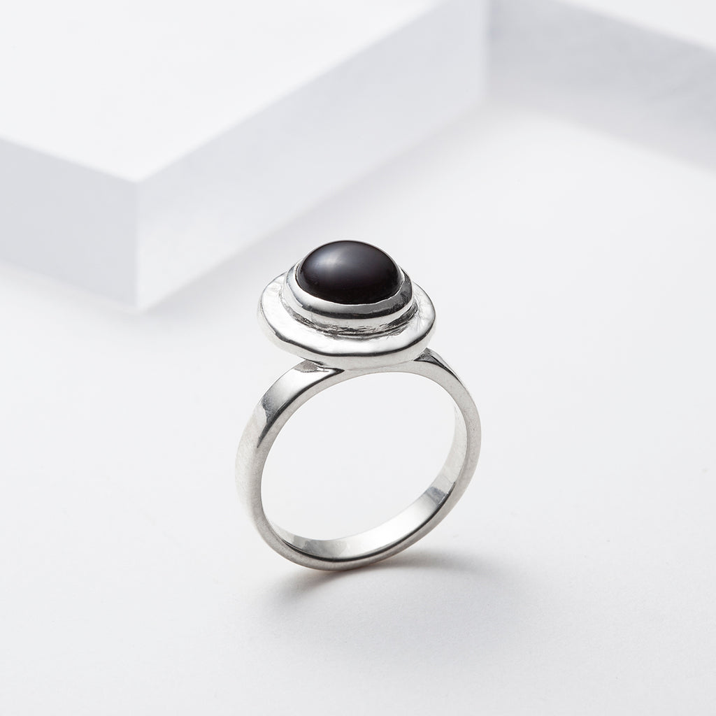 Off centered sterling silver black onyx ring