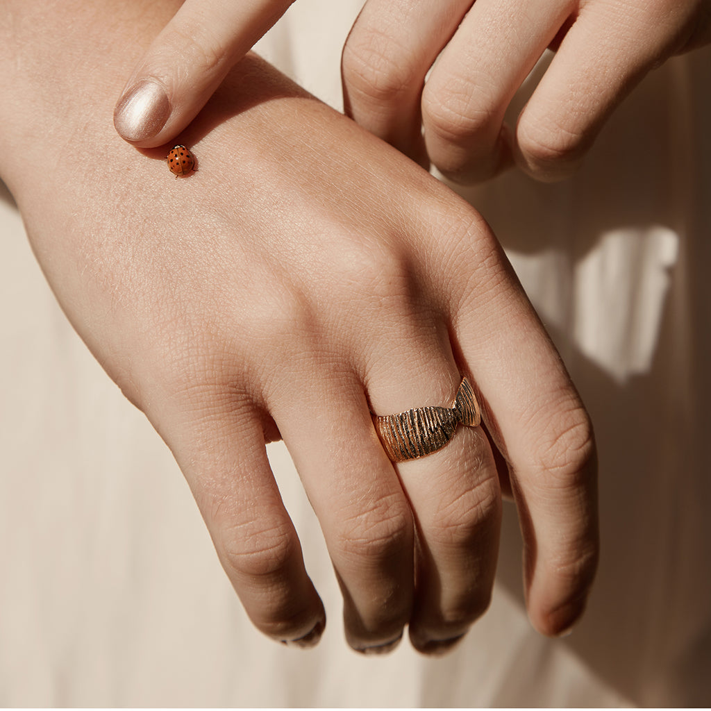 Ananke, gold plated wide band ring