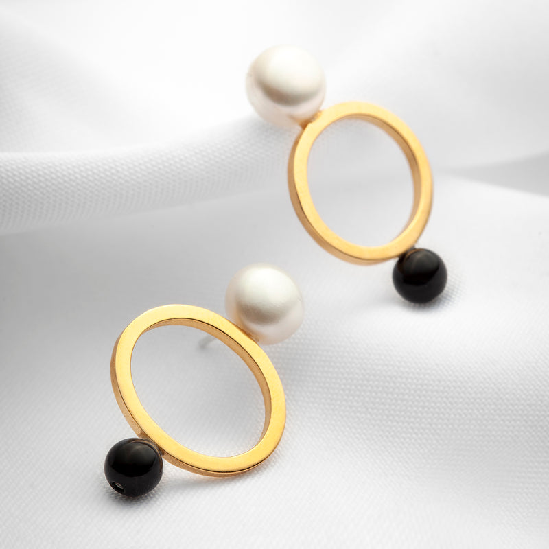 Gold large open oval stud earrings with big pearls and black onyx stones