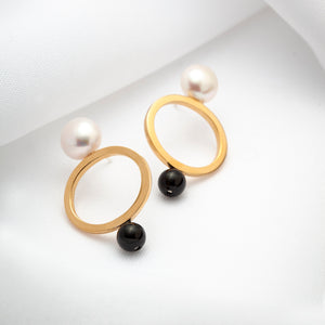 Gold plated open oval earrings with large pearls and black onyx stones