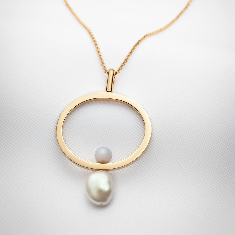 Long gold necklace with oval pendant big baroque pearl and blue lace agate stone
