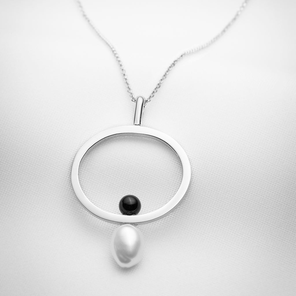 Sterling silver long pendant necklace with a single baroque pearl and black onyx