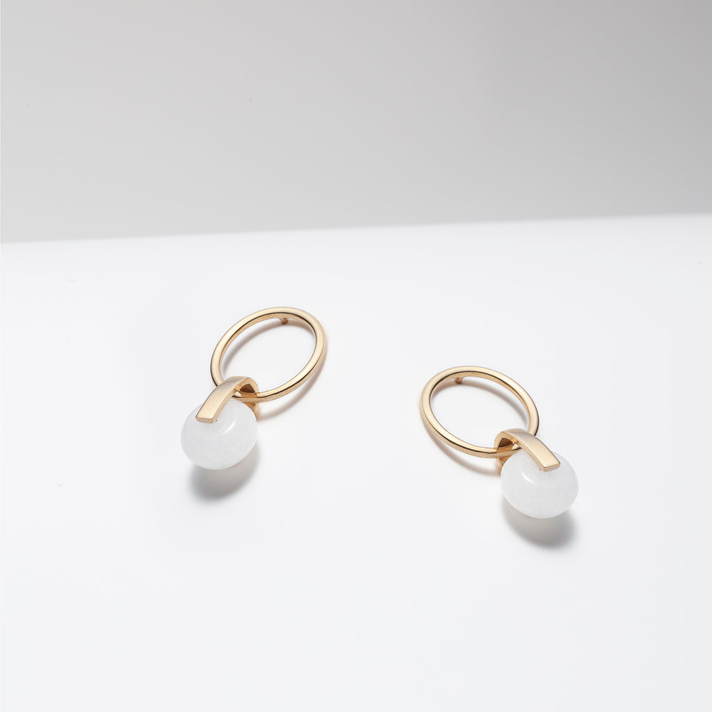 Gold plated hoop earrings with dangling white jade stone