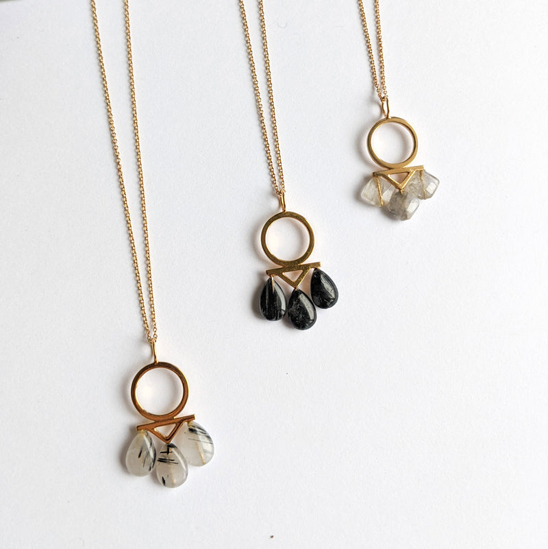 Gold plated onyx, rutilated quartz and onyx, three stones necklace