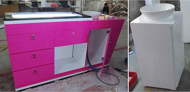 Pink vanity cabinet with hand basin