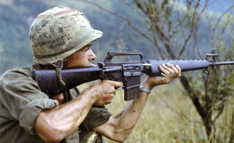 Rifleman points M16 during a firefight in Vietnam