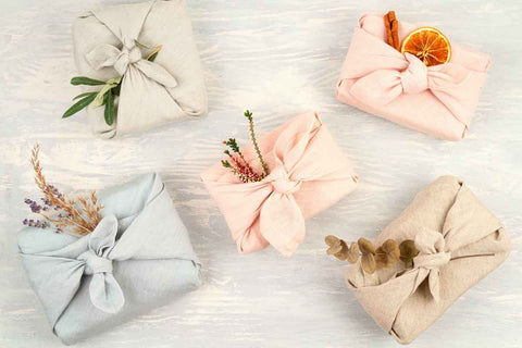 A picture of five gifts wrapped in Furoshiki - traditional Japanese wrap
