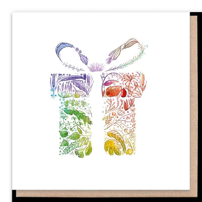 An image of a gift wrapped box in rainbow colours but when you look closely the image is made up from different coloured nature elements, including leaves and ferns.