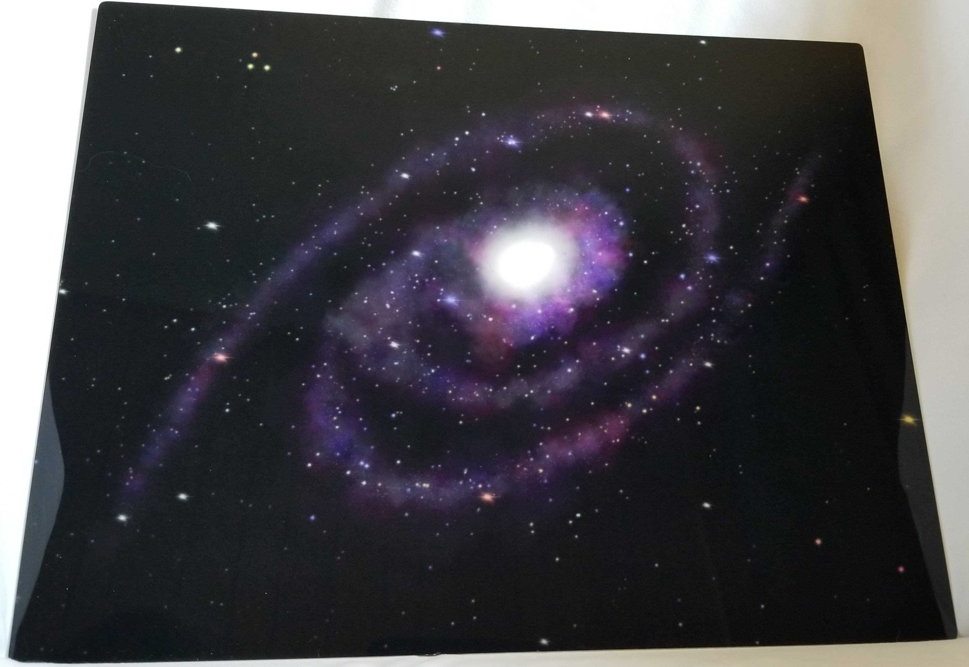 Digital drawing of a galaxy printed on aluminum.