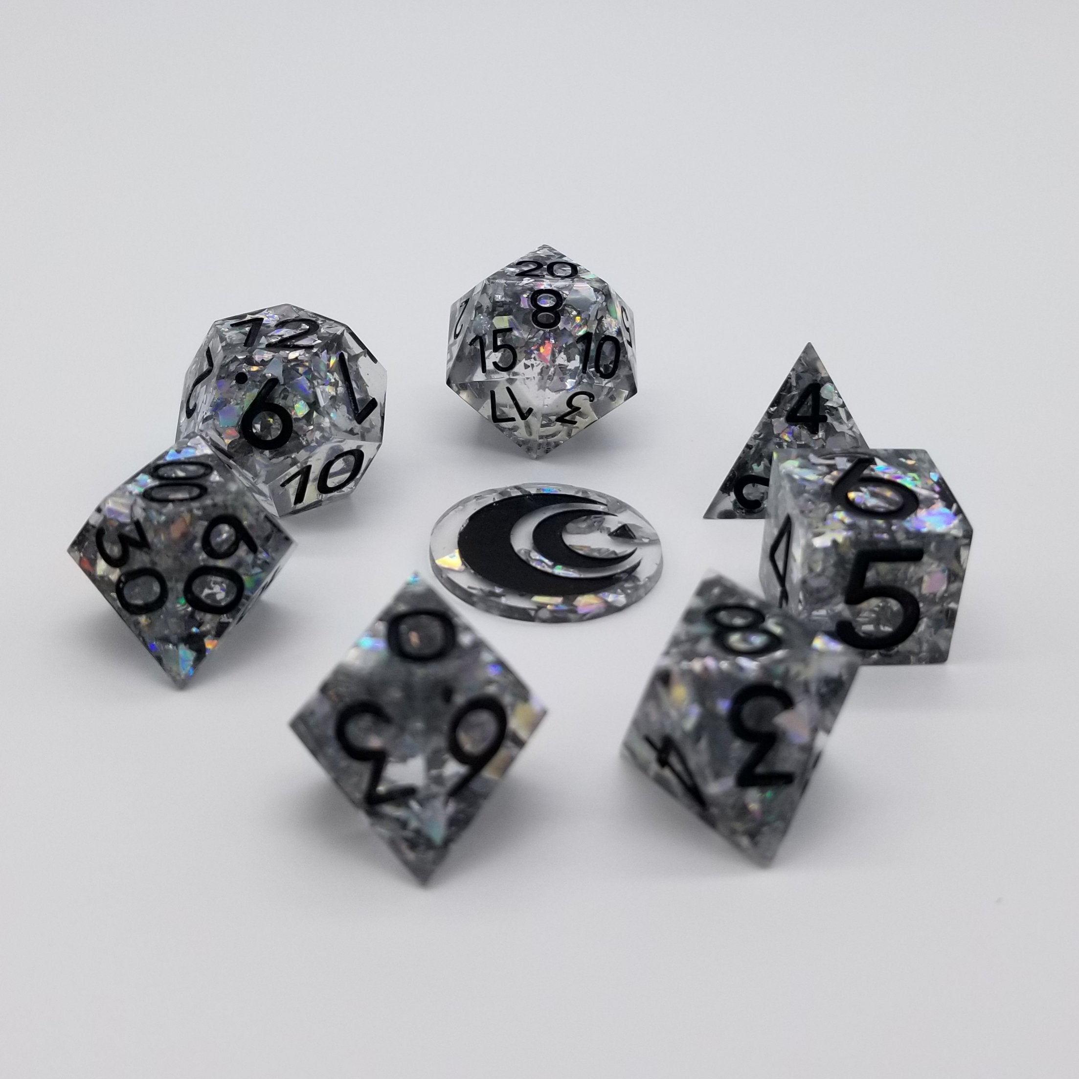 Clear dice with chunky holographic silver glitter inside and black ink.