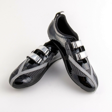Load image into Gallery viewer, Y³BLACK!, your tri version of the Y-series, comes with a shiny one-hand velcro flap, airy mesh, auto-reflective Y ornaments and of course - our unique twin cleat sole for those who want toprofit from a low, aero position and  run faster after their bike split..