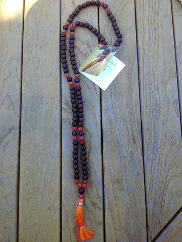 Mala: Dark sandalwood beads, carnelian and amethyst accent beads
