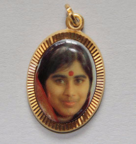 Mother Meera pendant with gold colored bezel