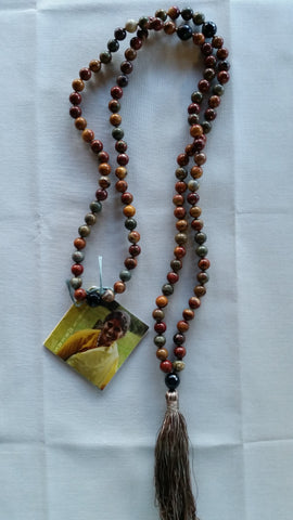 Mala: red creek jasper with faceted blue tigers eye accents and guru bead.