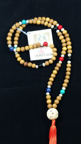 Sandalwood bead mala with freshwater pearls,  turquoise,  lapis  lazuli,  red coral and onyx