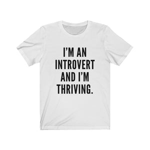 """I'm an introvert and I'm thriving."" Unisex Jersey Short Sleeve Tee"