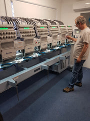 Embroidery machine for custom logo on shirts and tees