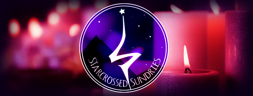 The starcrossed sundries logo overlaid over a row of burning candles, tinted red