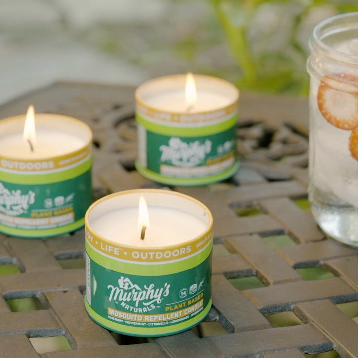 Load and play video in Gallery viewer, murphys naturals mosquito repellent candle trio pack on patio table in the backyard